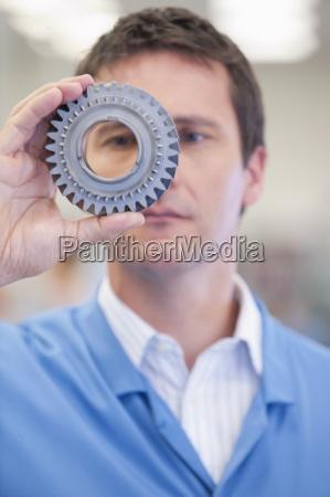 close up of engineer examining machine