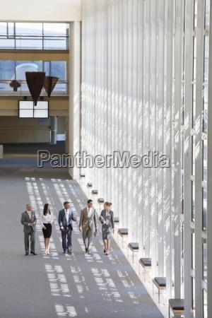 business people walking in lobby of
