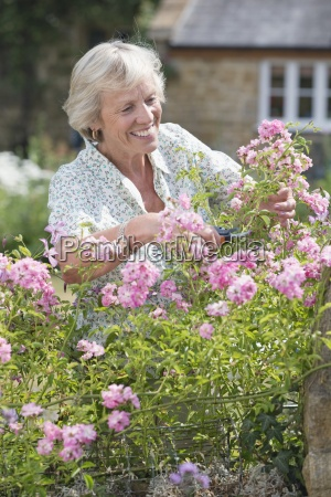 senior woman working in beautiful cottage