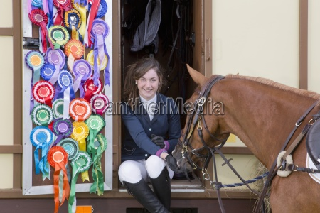 portrait of smiling girl in equestrian
