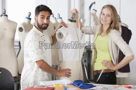 fashion design students working on garment