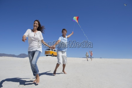 happy family with kite running on