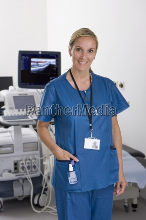 ultrasound technician standing with equipment