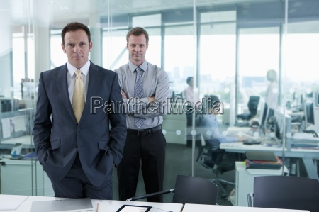 portrait of serious businessmen standing in