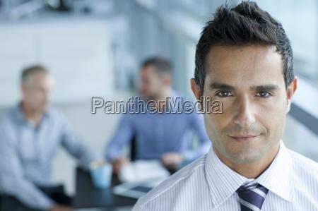 portrait of confident brunette businessman