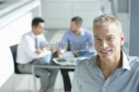 portrait of smiling businessman with co