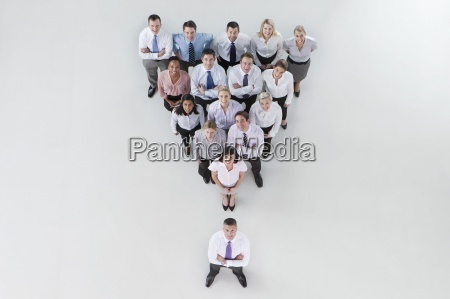 portrait of smiling business people forming