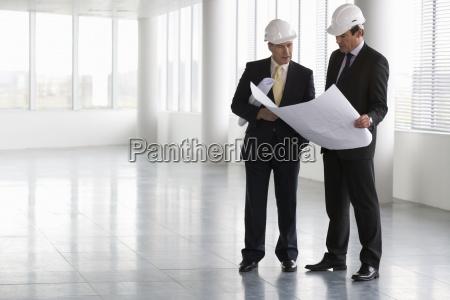 two people men mid adult men