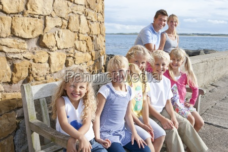 portrait of smiling family sitting near