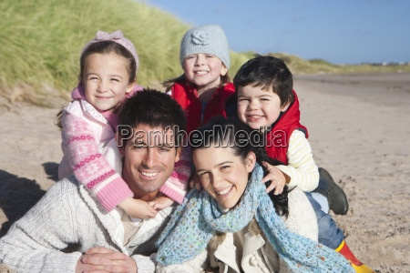 portrait of smiling family laying on