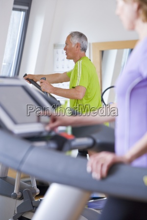 senior man and woman exercising on