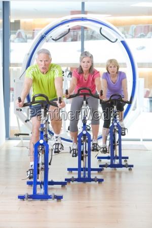 portrait of seniors on exercise bikes