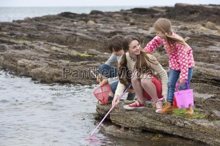 boy and girls fishing on rocks
