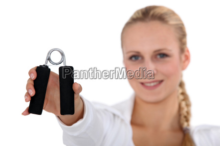 woman squeezing hand grippers