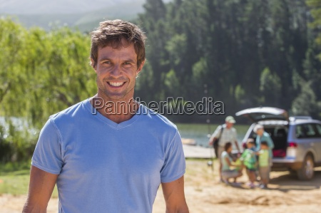 portrait of smiling man at lakeside