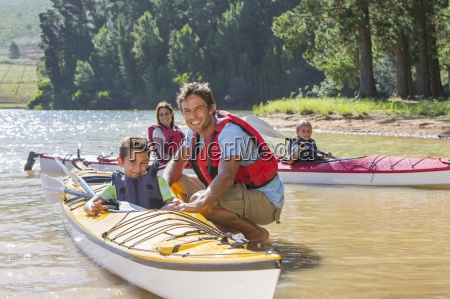 portrait of smiling family in kayaks