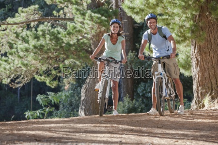 portrait of smiling couple on mountain