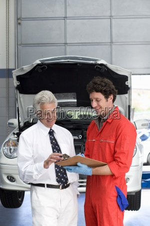 car mechanic in red overalls and