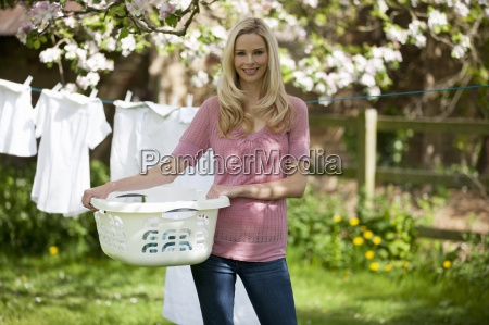 a young woman holding a washing