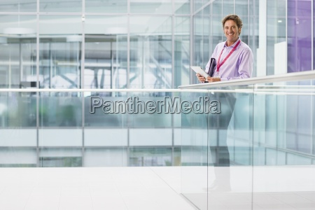 portrait of smiling businessman using digital