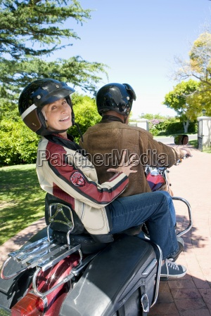 senior couple riding on motorbike senior