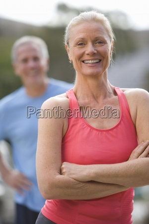 active senior couple in sportswear standing