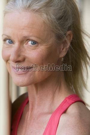 active senior woman wearing pink sports