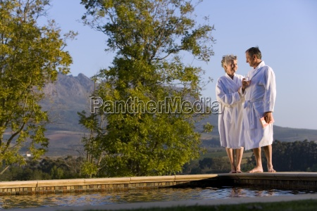 senior couple wearing white bath robes