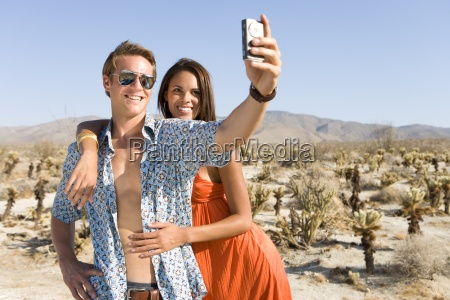 young couple taking photograph of themselves