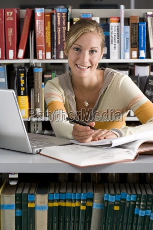 woman studying with laptop computer in