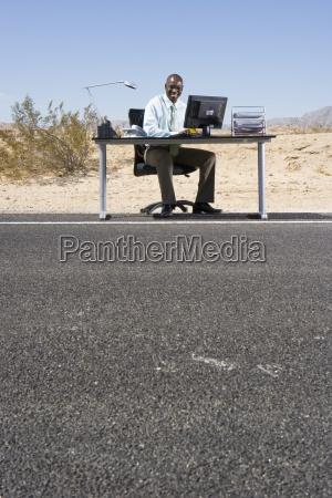 businessman at desk on side of