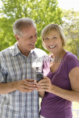 mature man smiling at woman with