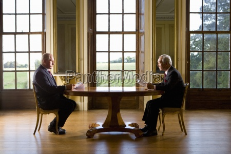 businessman and colleague with paperwork at
