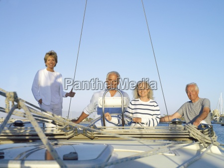 mature couple at wheel of boat
