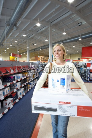 young woman in shop with computer