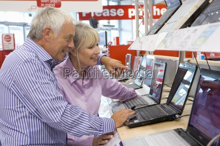 mature couple shopping for laptop computer