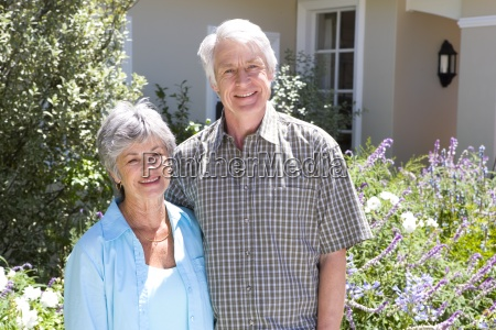 mature couple arm in arm outside