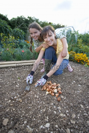 mother and daughter 7 9 gardening