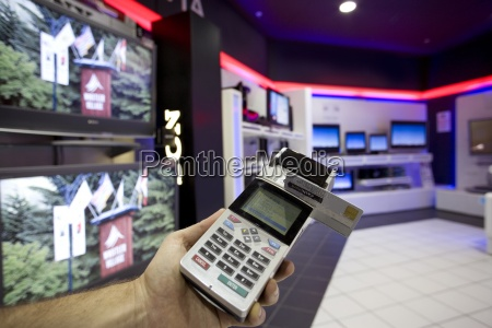 man with credit card machine in