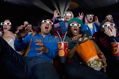 movie audience in 3d glasses making