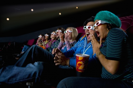 audience in cinema wearing 3d glasses