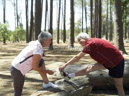 active senior couple in sportswear warming