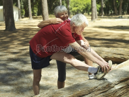 active senior couple in sportswear warming