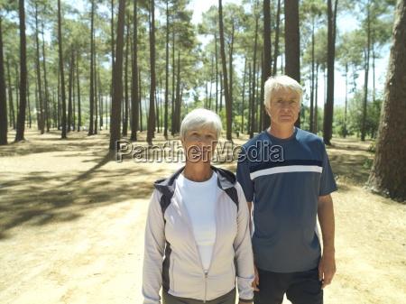 senior couple in sportswear standing in