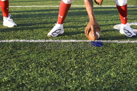 american football running back in red