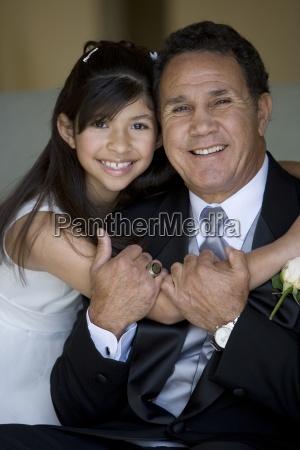 senior man embracing granddaughter 8 10