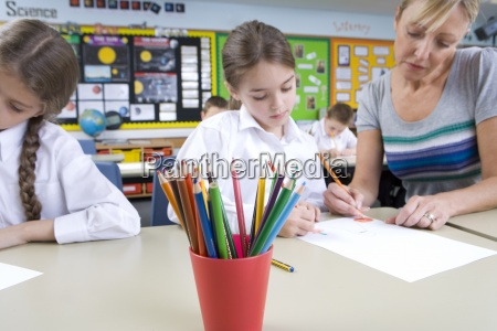 teacher helping student with school work