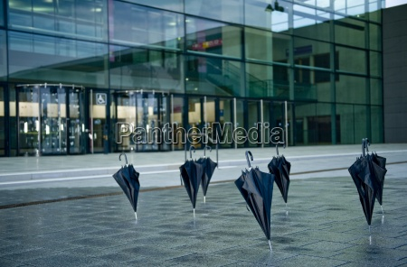black umbrellas standing upright outside a