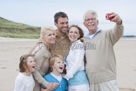 taking photo of multi generation family