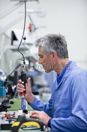 technician working in hi tech electronics